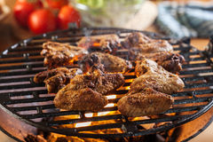 Grilling chicken wings on barbecue grill Royalty Free Stock Photo