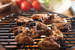 Grilling chicken wings on barbecue grill Royalty Free Stock Photos