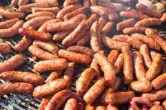 Grilling chorizos Royalty Free Stock Photos