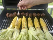 Grilling corn and beef royalty free stock images
