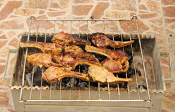 Grilling of delicious mutton chops. Barbeque of marinated mutton chops royalty free stock photo