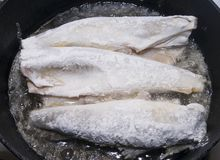 Grilling fish Stock Photography