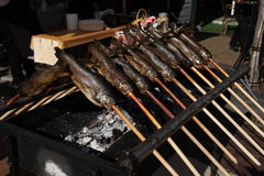 Grilling fish, fried fish. Street, Lithuania Royalty Free Stock Photos