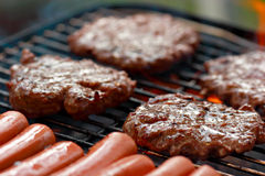Grilling food Stock Images