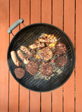 Grilling Food. On a charcoal grill Royalty Free Stock Photo