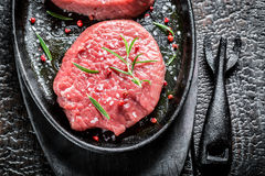 Grilling fresh piece of beef with rosemary Royalty Free Stock Image