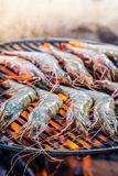 Grilling fresh prawns with lemon and parsley Royalty Free Stock Photography