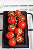 Grilling fresh tomatoes Royalty Free Stock Image