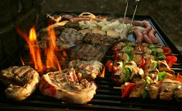 Grilling for friend and family. The perfect grilled stake makes friends Royalty Free Stock Photo