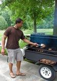 Grilling Hamburgers Stock Image
