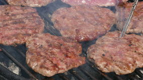 Grilling hamburgers, barbecue stock footage