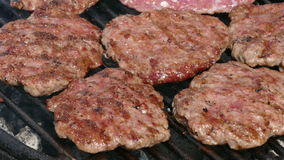 Grilling hamburgers, barbecue stock video