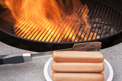 Grilling hot dogs Royalty Free Stock Image