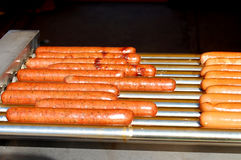 Grilling hot dogs Royalty Free Stock Photography