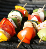Grilling kabobs Royalty Free Stock Photo