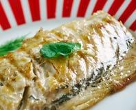 Grilling mackerel Royalty Free Stock Images