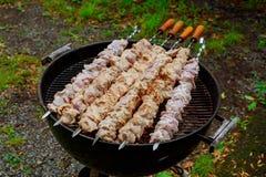 Grilling marinated shashlik on a grill. Shashlik is a form of Shish kebab Royalty Free Stock Photos