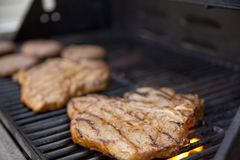 Grilling meat Stock Photos