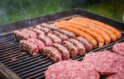 Grilling Meat on barbecue grill with coal. Stock Image