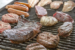 Grilling Meats at Outdoor Picnic Stock Images