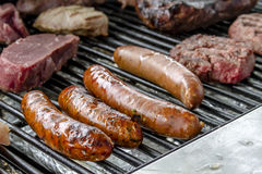 Grilling Meats at Outdoor Picnic Stock Photo
