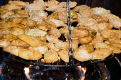 Grilling the oscypek. Oscypek is a smoked cheese made of salted. Sheep milk stock image