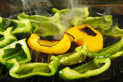Grilling peppers Royalty Free Stock Photos