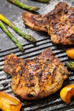 Grilling Pork Chops Royalty Free Stock Photos