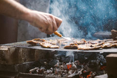 Grilling pork meat chops on barbecue Stock Photography