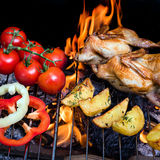 Grilling poultry quails and fresh juicy vegetables in a restaurant Royalty Free Stock Image
