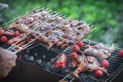 Grilling poultry quails stock image