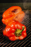 Grilling red peppers Stock Photos