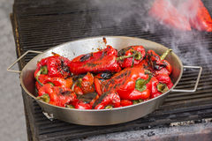 Grilling red peppers Stock Images