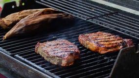 Grilling rib eye steaks stock photo