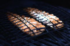 Grilling salmon Royalty Free Stock Images