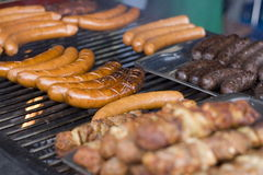 Grilling sausage Stock Image