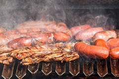 Grilling sausage Royalty Free Stock Photography