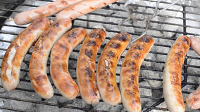 Grilling sausage stock video footage