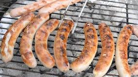 Grilling sausage Royalty Free Stock Image