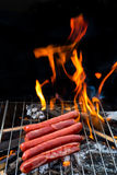 Grilling sausages on barbecue Stock Photography