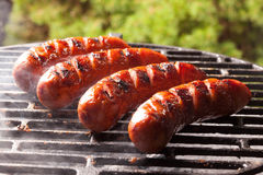 Grilling sausages. Stock Photography