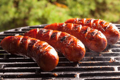 Grilling sausages. Royalty Free Stock Image