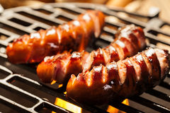 Grilling sausages on barbecue grill Royalty Free Stock Photo