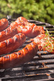 Grilling sausages. Stock Image
