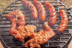 Grilling sausages. Royalty Free Stock Photography