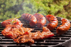 Grilling sausages. Stock Photos