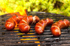 Grilling sausages. Stock Photo