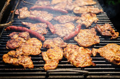 Grilling sausages and meat Stock Photo