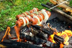Grilling sausages Royalty Free Stock Photo