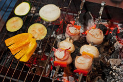Grilling scallops Stock Photo